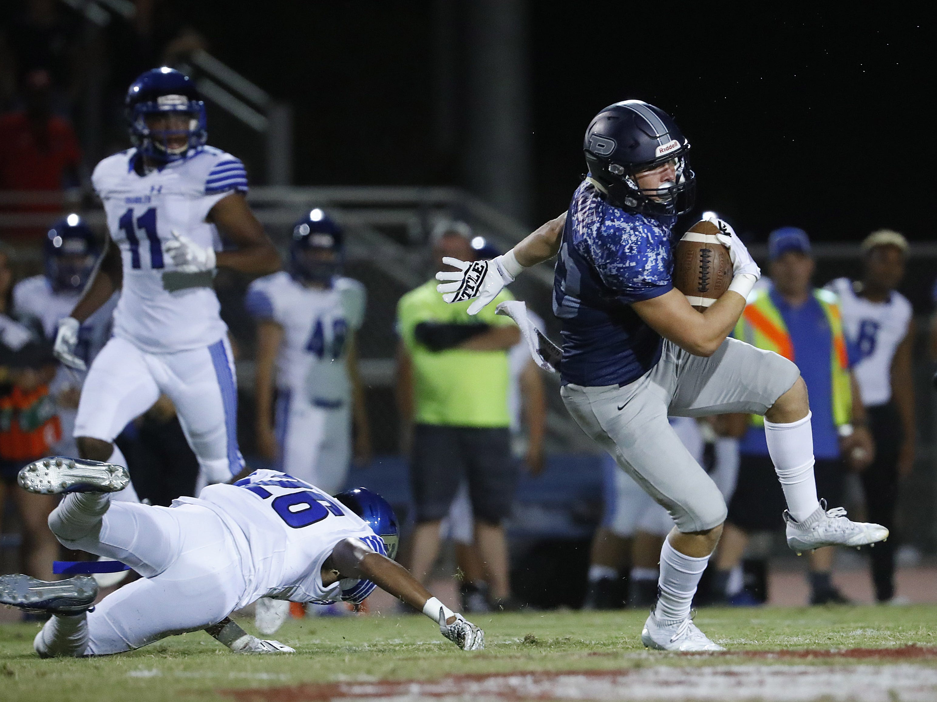 Perry's Connor Boyd (83) spins off a tackle from Chandler's Andrew Kirk (26) at Perry High School in Gilbert, Ariz. on Sept. 28, 2018.  #azhsfb