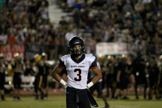 Williams Field's Noa Pola-Gates looks toward the middle of the field in game against Gilbert on Friday night at Gilbert High School on Sept. 28, 2018.