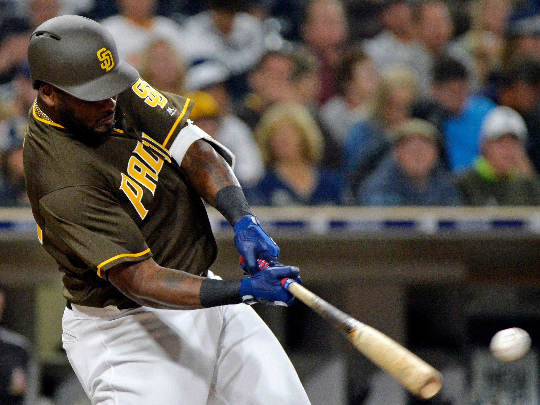 Sep 28, 2018: San Diego Padres right fielder Franmil Reyes (32) singles in the fourth inning against the Arizona Diamondbacks at Petco Park.