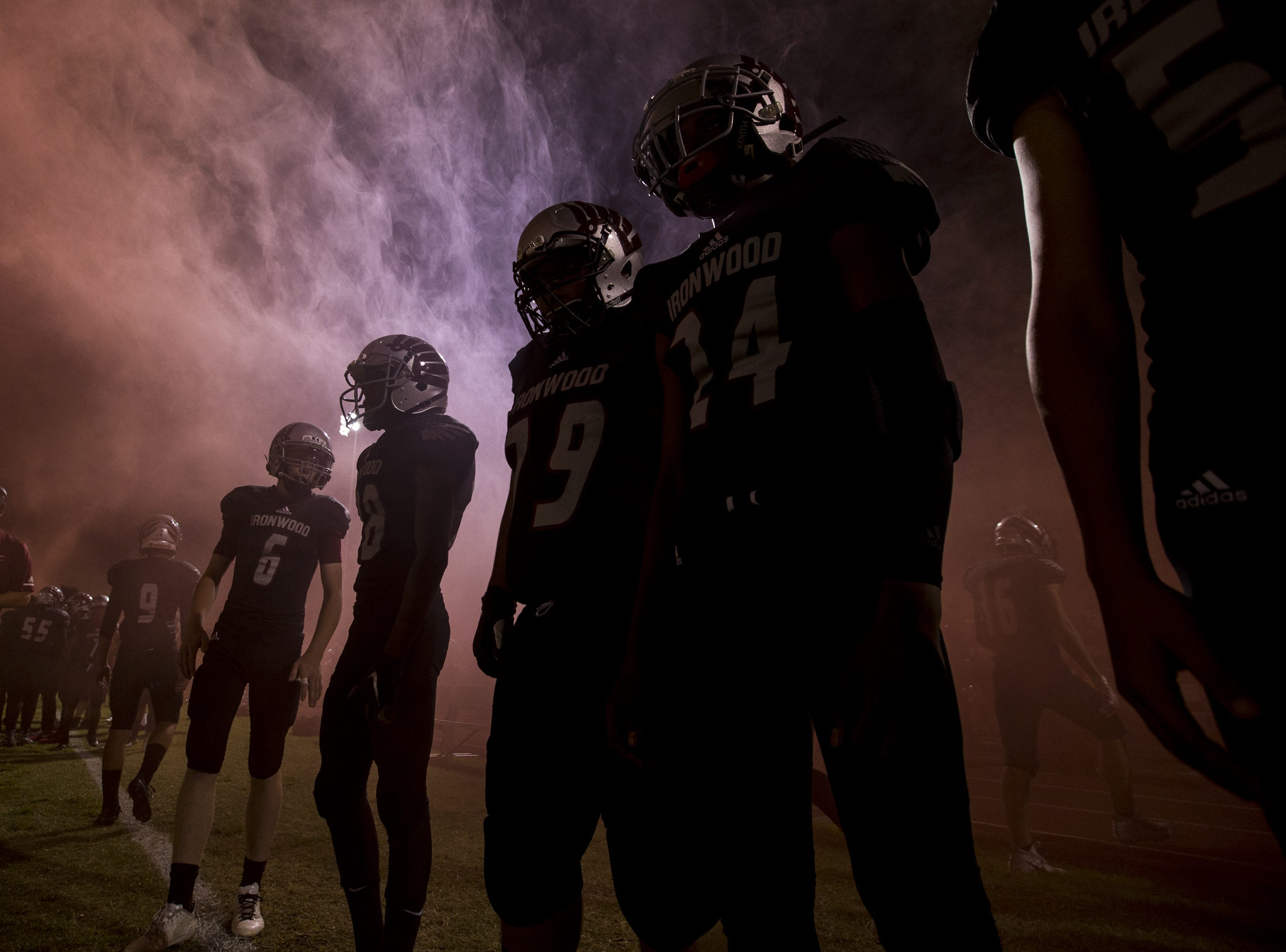 Ironwood players stand on the sideline before the game against Sunrise Mountain on Friday, Sept. 28, 2018, at Ironwood High School in Glendale, Ariz.  #azhsfb