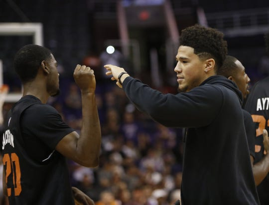 Suns Devin Booker greets teammates during an Open Practice at Talking Stick Resort Arena in Phoenix, Ariz. on Sept. 29, 2018.