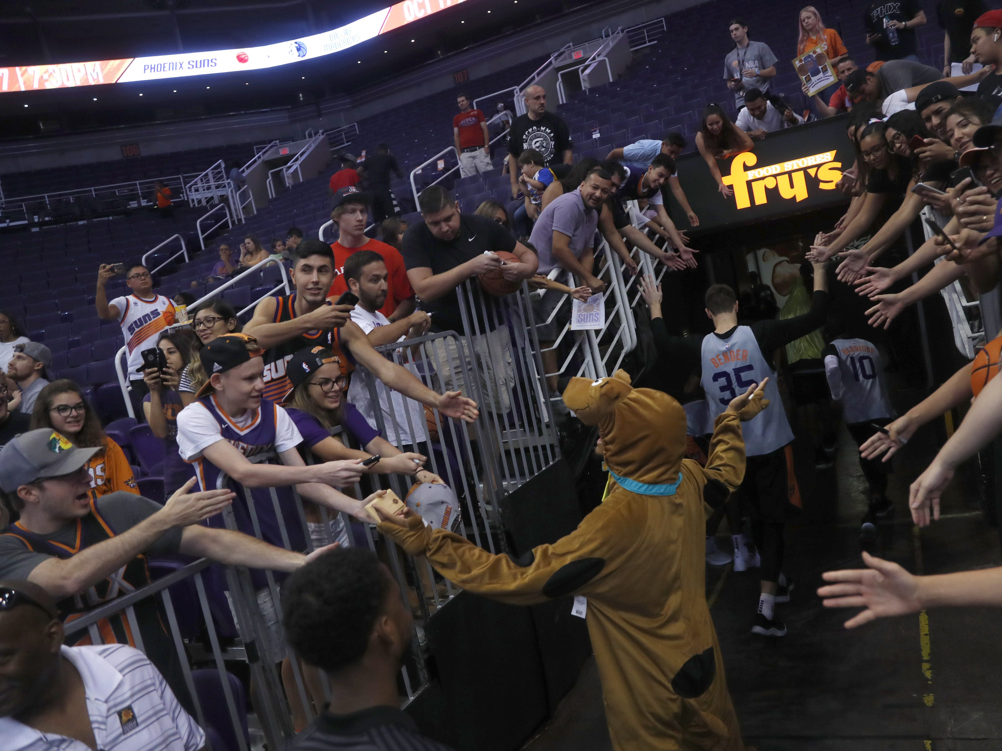 Suns Ellie Okobo, wearing a Scooby Doo outfit makes his way off the court during an Open Practice at Talking Stick Resort Arena in Phoenix, Ariz. on Sept. 29, 2018.