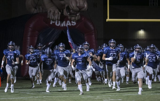 Perry takes the field to play Chandler at Perry High School in Gilbert, Ariz. on Sept. 28, 2018.  #azhsfb