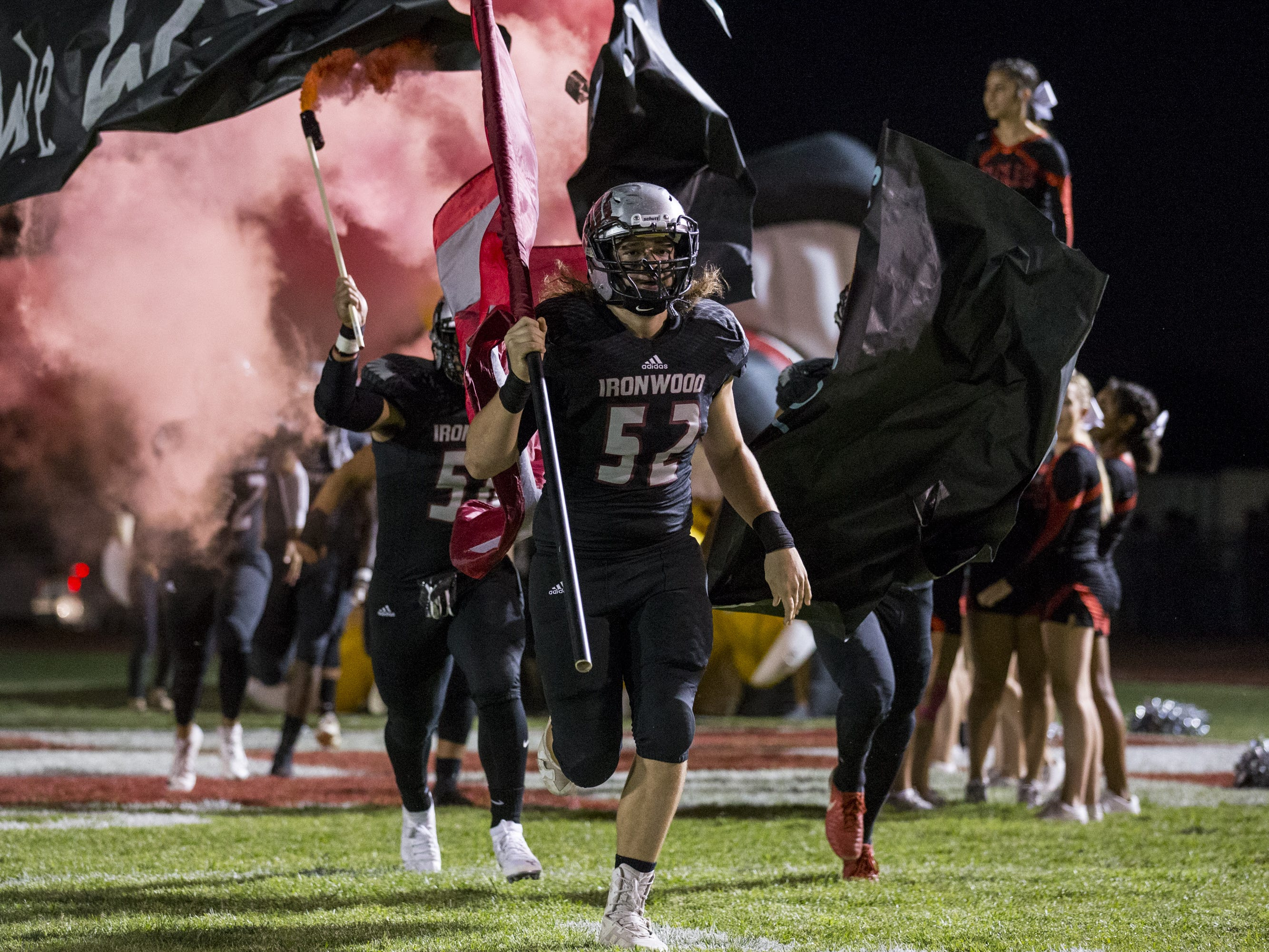 Ironwood takes the field before the game against Sunrise Mountain on Friday, Sept. 28, 2018, at Ironwood High School in Glendale, Ariz.  #azhsfb