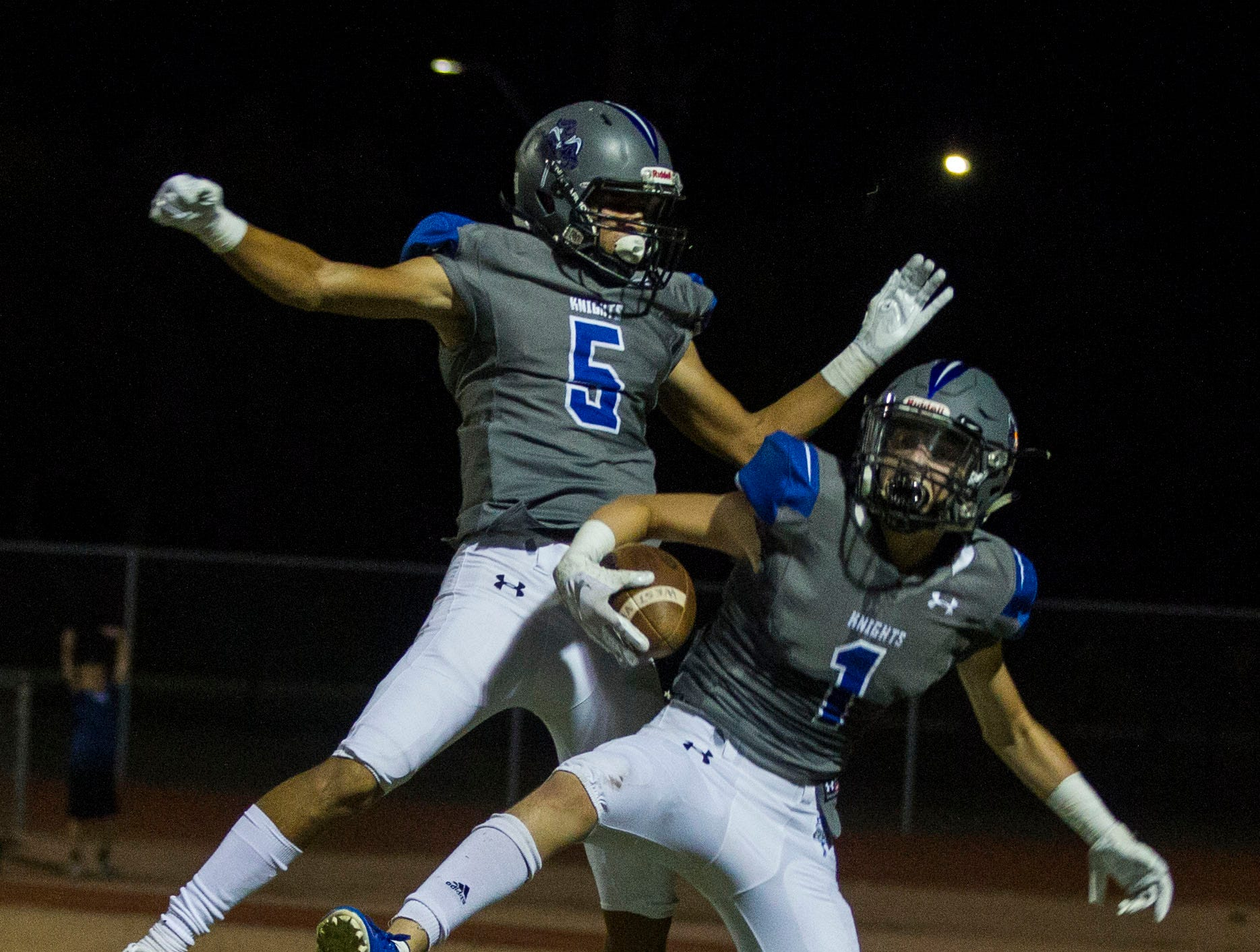Westview's Isac Hall (5) celebrates with Nathan Young (1) after Young's touchdown against Tolleson during their game in Avondale Friday, Sept. 28, 2018. #azhsfb