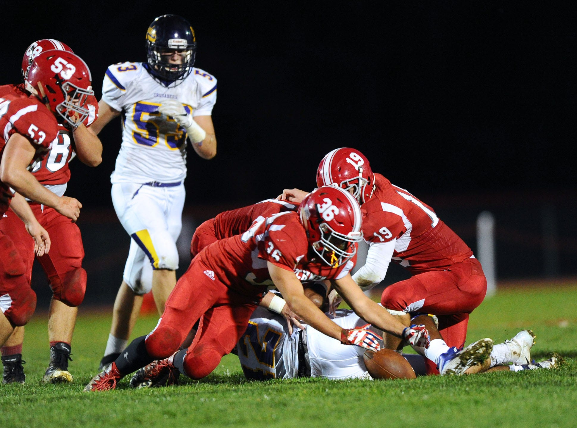 Annville Cleona's Romeo Varela (36) recovers a fumble during the 1st quarter of  Friday night's game against Lancaster Catholic.