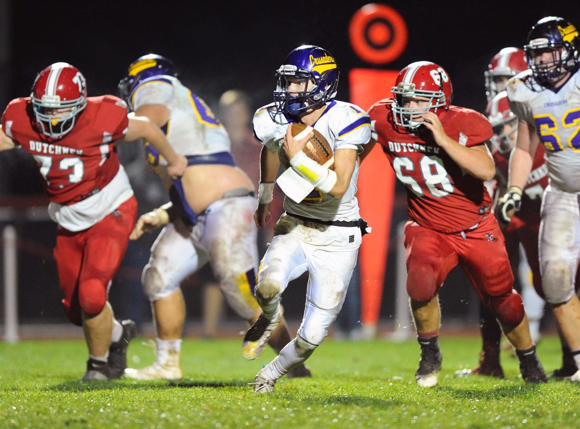 Lancaster Catholic QB Gavin Sullivan (1) outruns Annville Cleona's Logan Wagner as he runs for a 4th quarter touchdown to put Lancaster Catholic up 23-7 in Friday night's game against Lancaster Catholic.