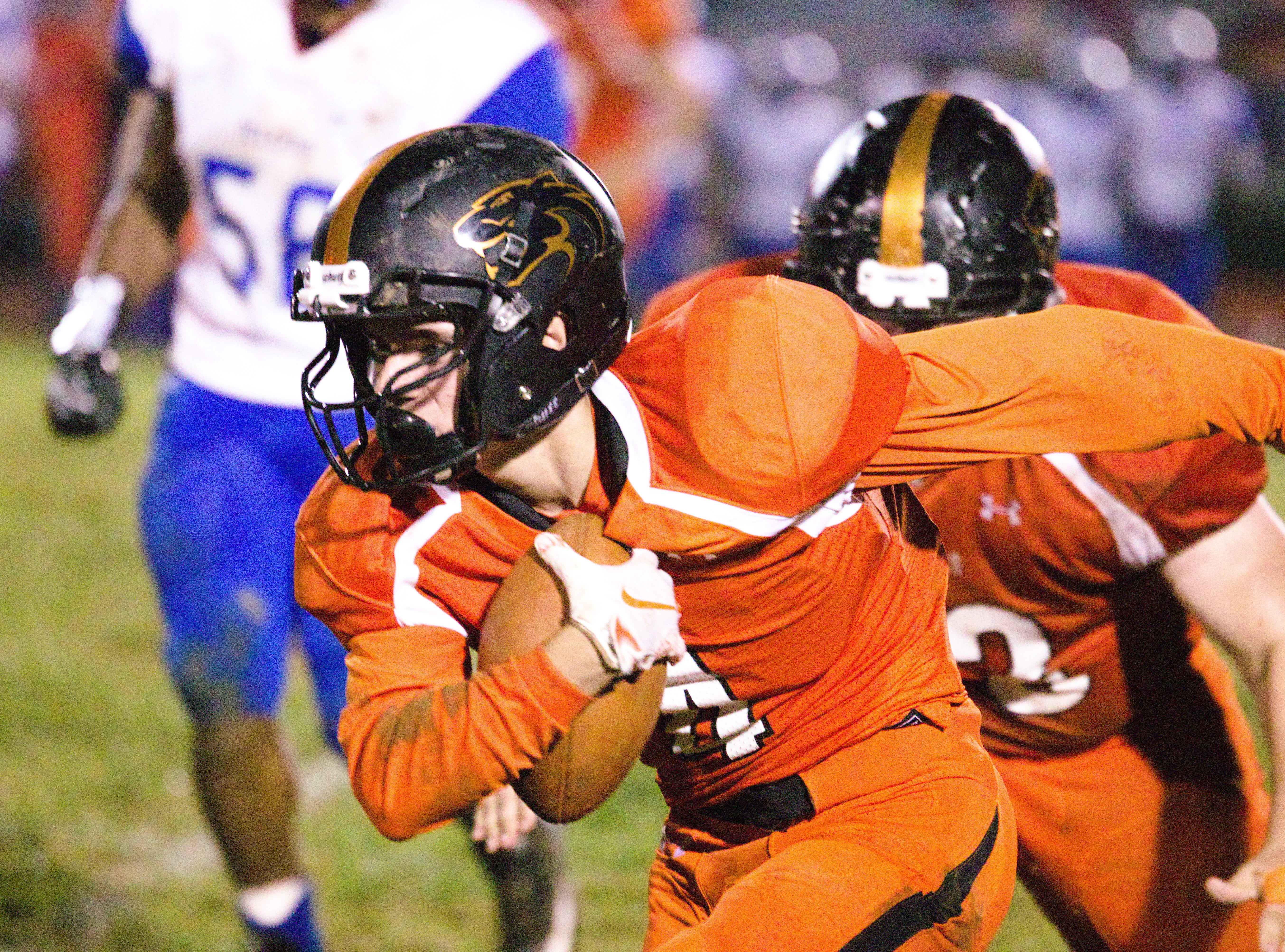 Palmyra's Nick Morder looks for running room after one of his 5 receptions.