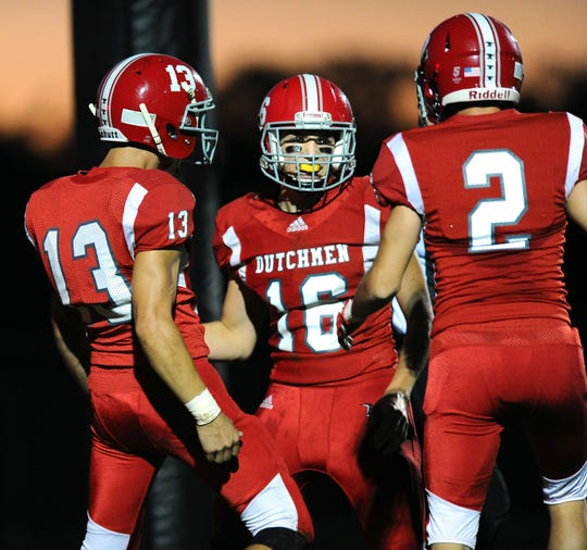 Annville-Cleona QB Jeremy Bours (16) is met by teammates Gabriel Burris (13) and Hayden Funck (2) in the end zone after he scores AC's first TD of last month's game against Lancaster Catholic. Despite a bevy of injuries, A-C is in the district playoff hunt heading into Friday's matchup with Elco.