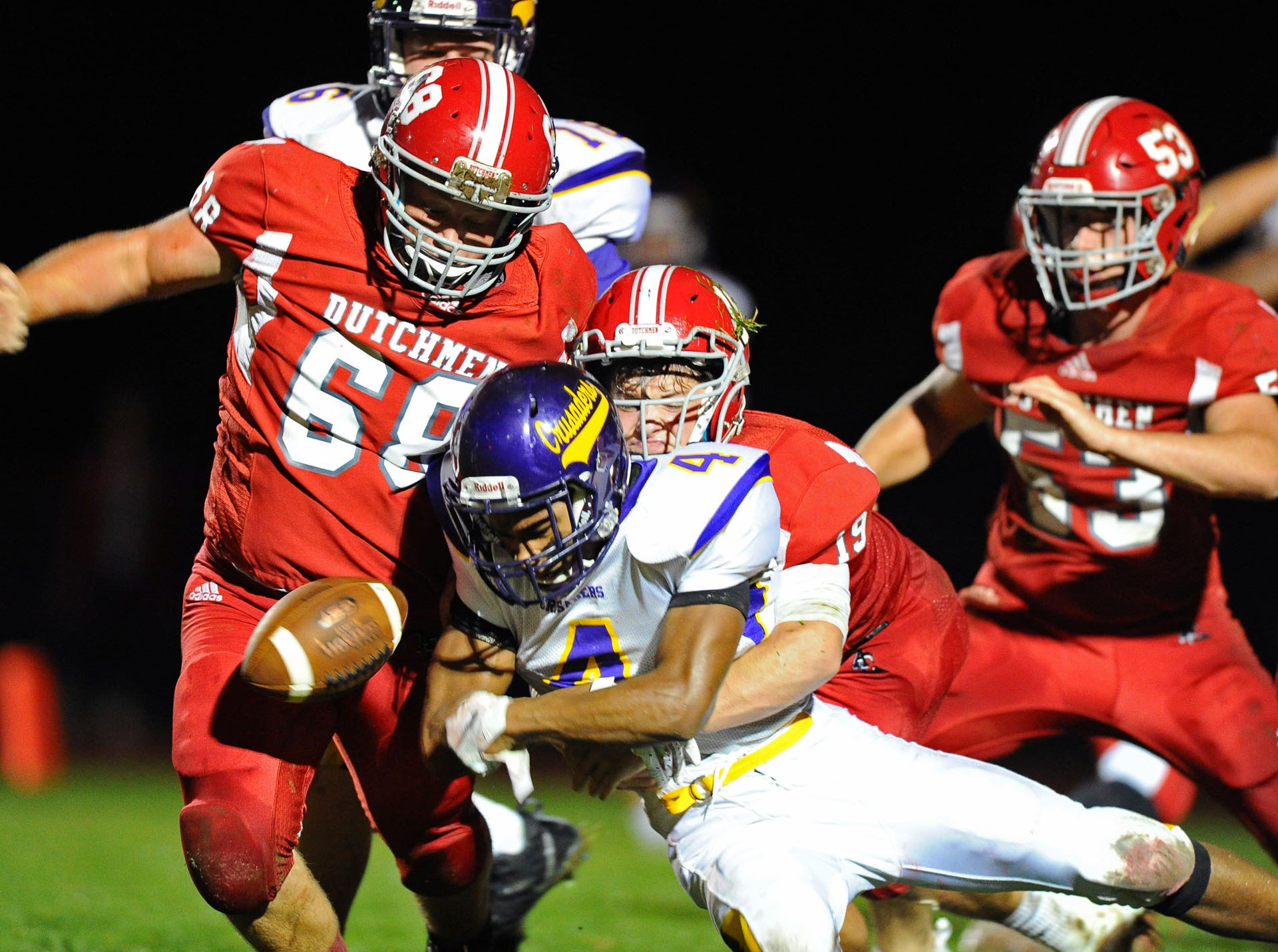 Lancaster Catholic's Malkam Lawrence (4) is stopped by Annville Cleona's Daniel Tobias (19) on this 2nd and goal play during the 1st quarter of Friday night's game against Lancaster Catholic.