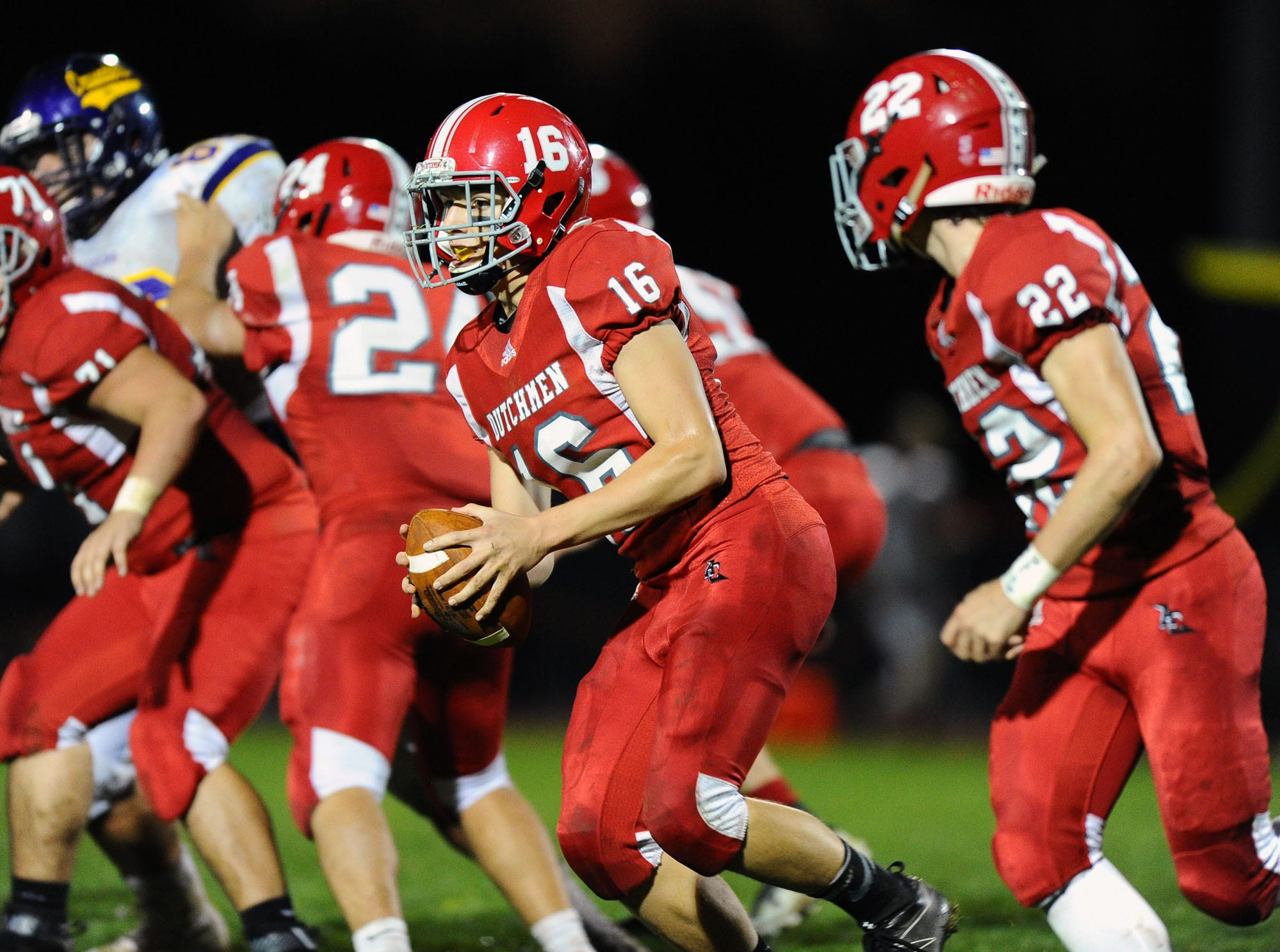 Annville-Cleona QB Jeremy Bours (16) tosses the ball to RB Tyler Long (22) during the 3rd quarter of Friday night's game against Lancaster Catholic.