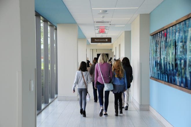 Visitors walk one of the hallways during an open house for McLaren Port Huron hospital's new South Tower on Saturday, Sept. 29, 2018.