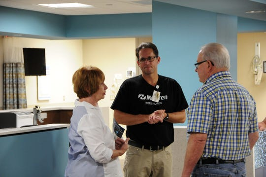 David Monan, center, Emergency Room director at McLaren Port Huron, talks with visitors during an open house for the hospital's new South Tower on Saturday, Sept. 29, 2018.