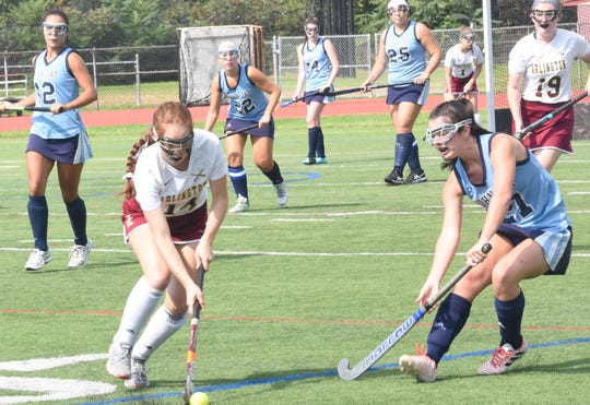 Arlington's Emily Strutt is guarded by John Jay's Alyssa Caswell as she drives up field during a Sept. 29 game.