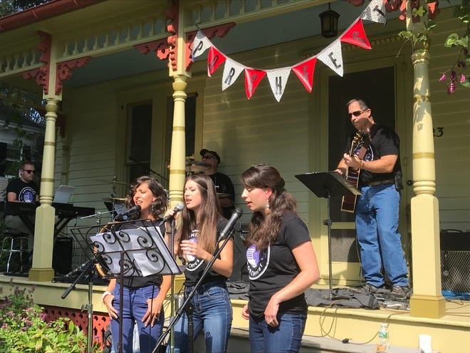 The Rhinebeck Taylor shop quartet and Friends perform at Rhinbeck Porchfest Saturday. On vocals, from left, are sisters Annemarie Thimons, Alyssa Nuzzo and Katie Luangkhot. Their father, Rick Nuzzo, is on guitar, Artie Rosato plays drums and Michael McCabe plays keyboards.
