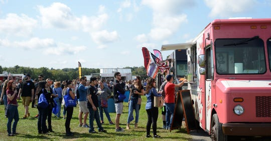People enjoy the second annual Wine, Cider and Food Truck Festival at Stormville Airport on Saturday.