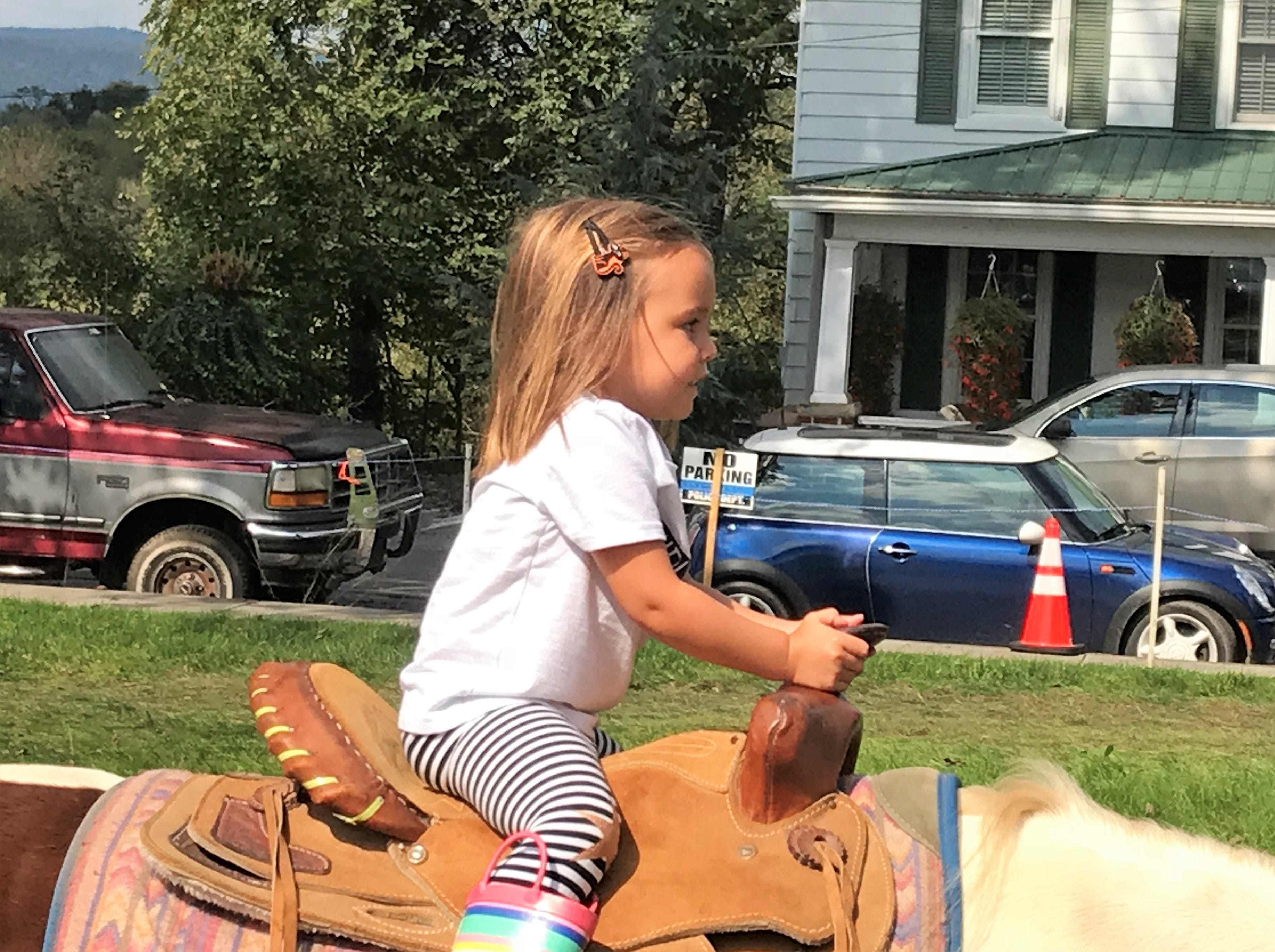 Olivia Cook rides a pony on Saturday, Sept. 29, 2018, at Mercersburg Townfest.