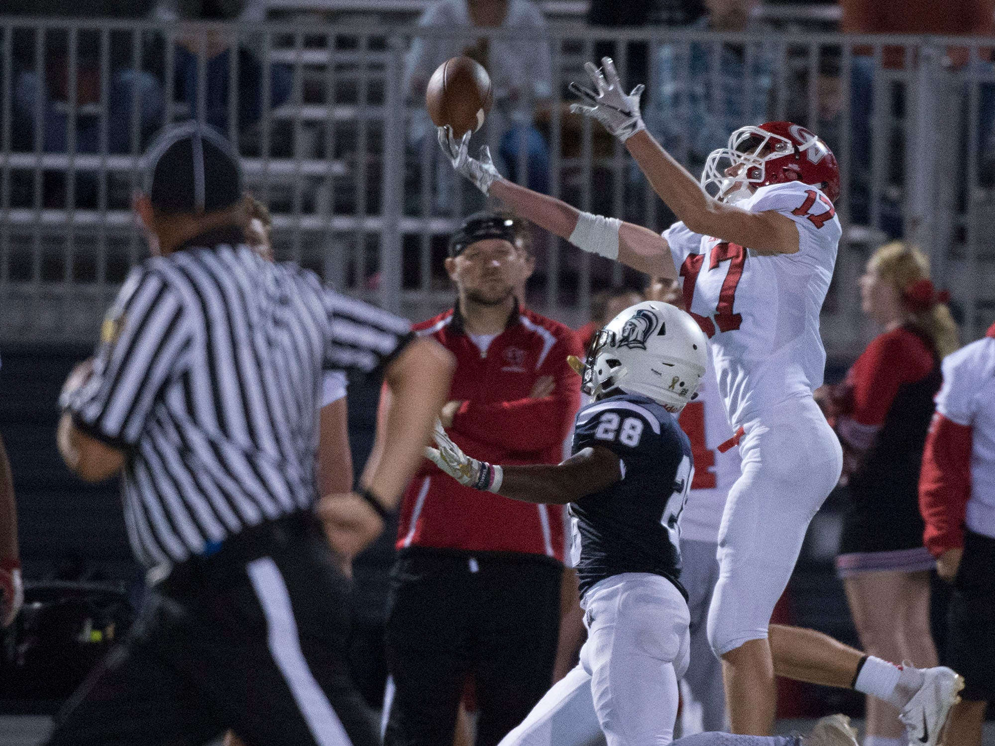 Keyshawn Jones (28) breaks up a pass intended for CV's Logan Ramper (17). Chambersburg Trojans are 5-1 after a homecoming victory over Cumberland Valley 28-14 in PIAA football on Friday, Sept. 28, 2018.