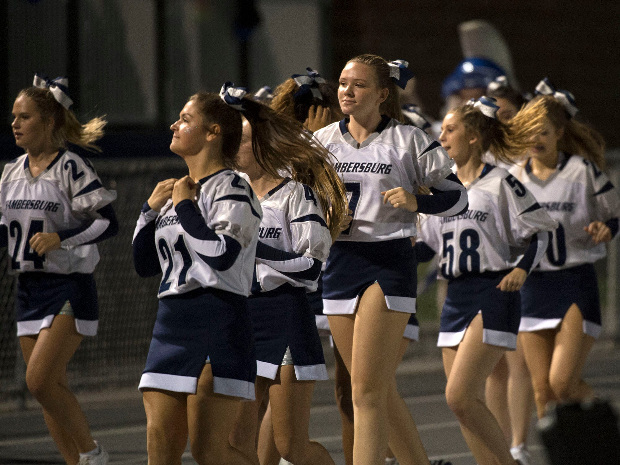 Cheerleaders celebrate following a score. Chambersburg Trojans are 5-1 after a homecoming victory over Cumberland Valley 28-14 in PIAA football on Friday, Sept. 28, 2018.
