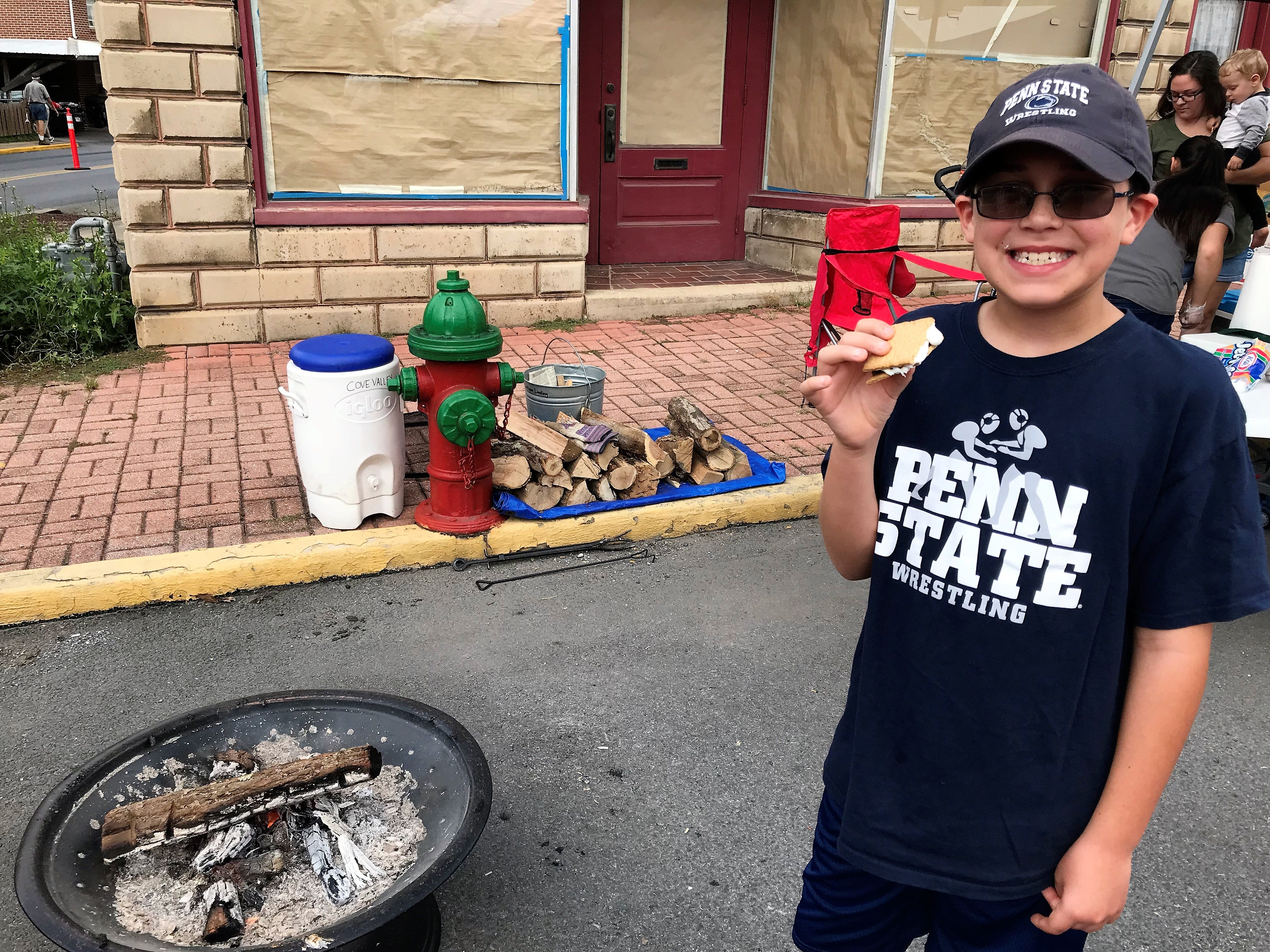 Landon Shaker, Chambersburg, made a S'more at the Cove Valley Christian Youth Camp stand on Saturday, Sept. 29, 2018, at Mercersburg Townfest.