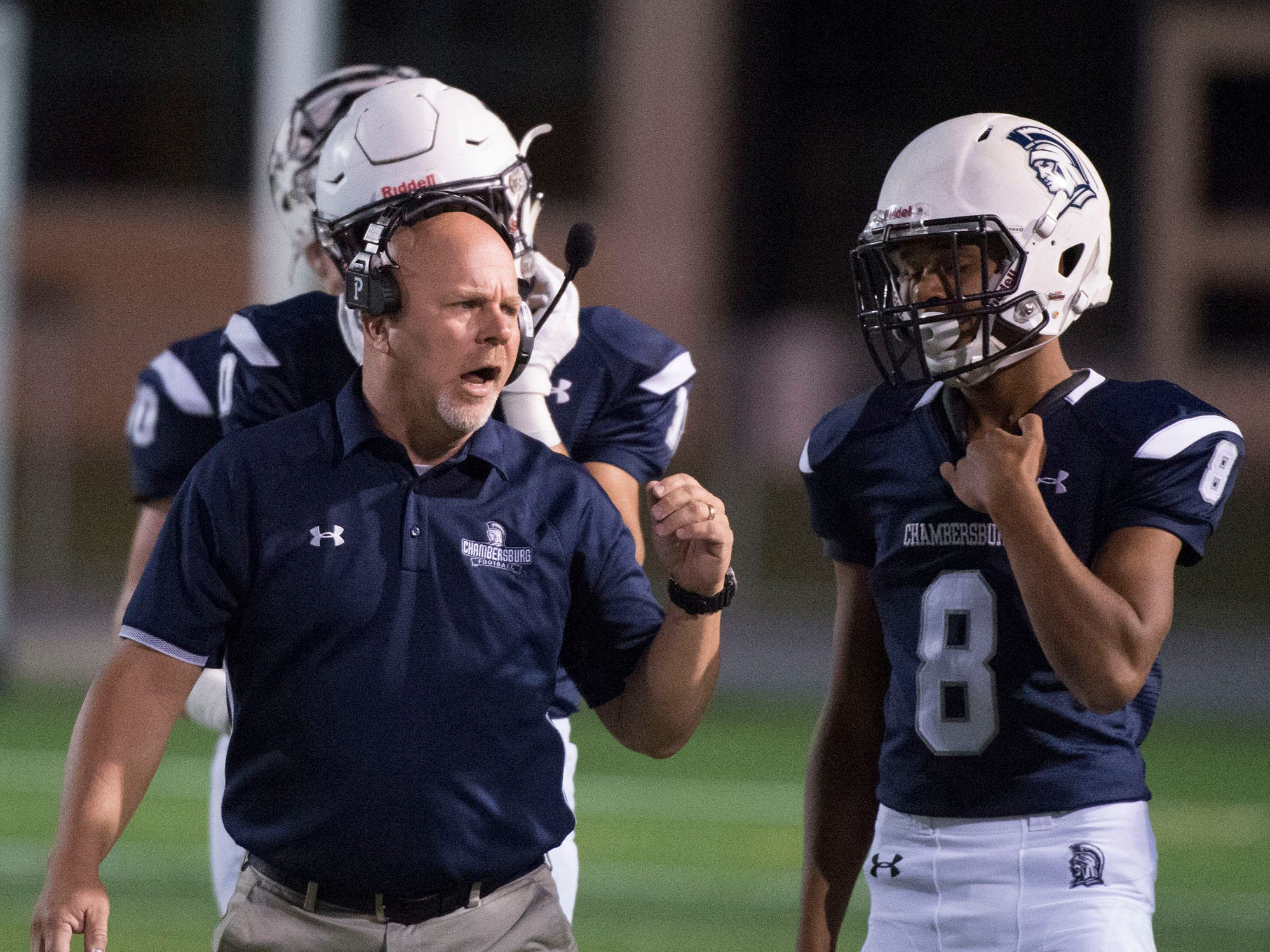 Chambersburg coach Mark Luther talks to player Karter Jones. Chambersburg Trojans are 5-1 after a homecoming victory over Cumberland Valley 28-14 in PIAA football on Friday, Sept. 28, 2018.