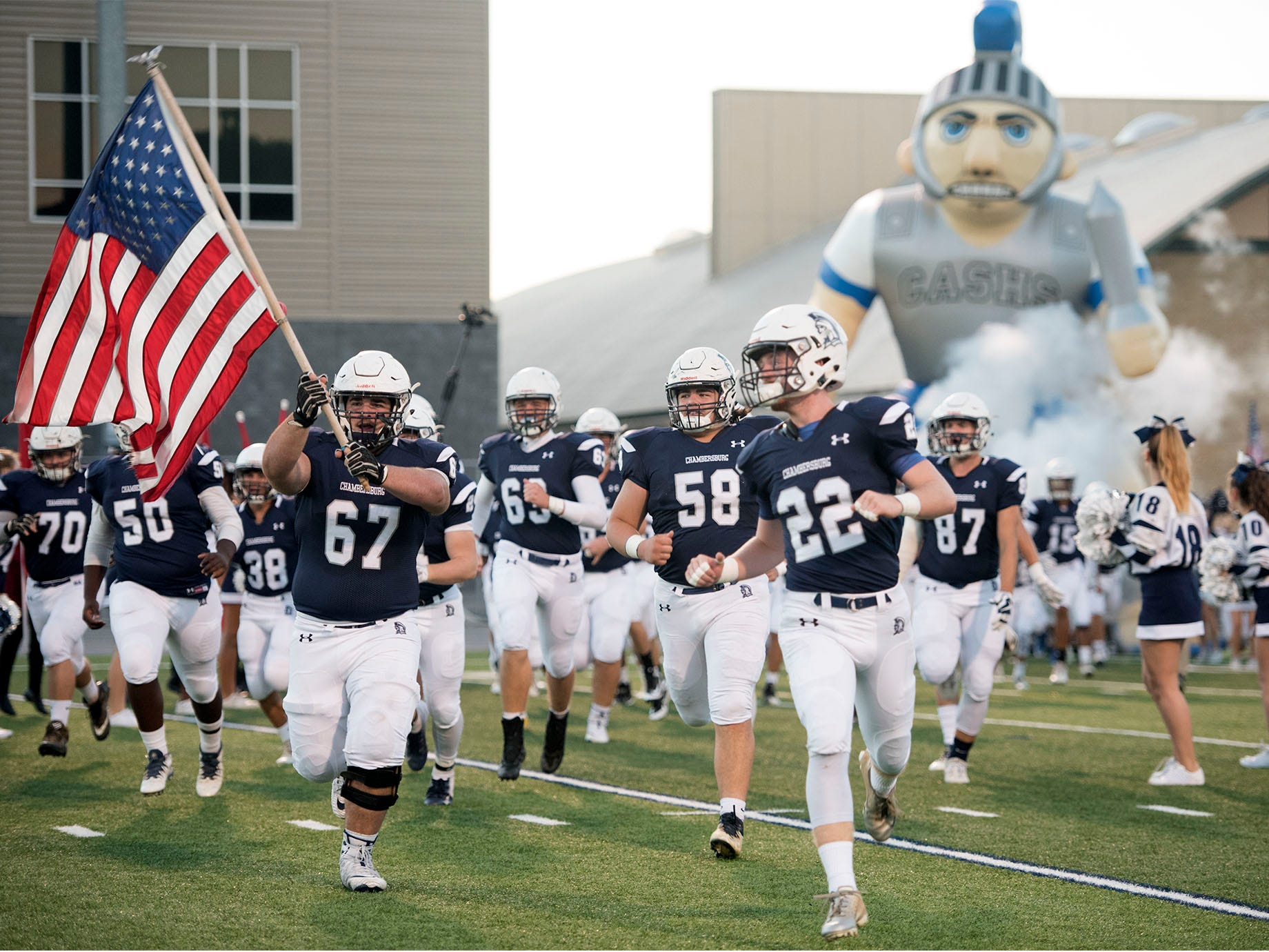 Chambersburg Trojans run onto the field. Chambersburg Trojans are 5-1 after a homecoming victory over Cumberland Valley 28-14 in PIAA football on Friday, Sept. 28, 2018.