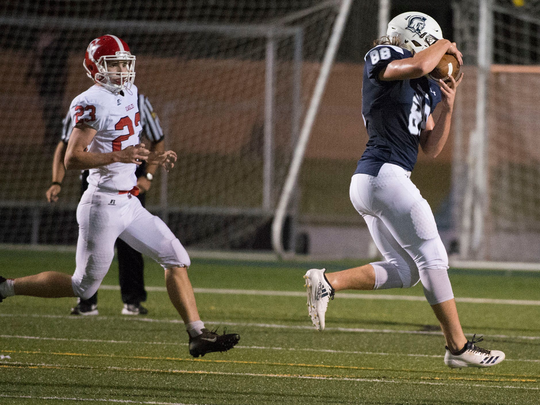 Chambersburg's Garner Funk (88) catches a pass and scores fot the Trojans. Chambersburg Trojans are 5-1 after a homecoming victory over Cumberland Valley 28-14 in PIAA football on Friday, Sept. 28, 2018.