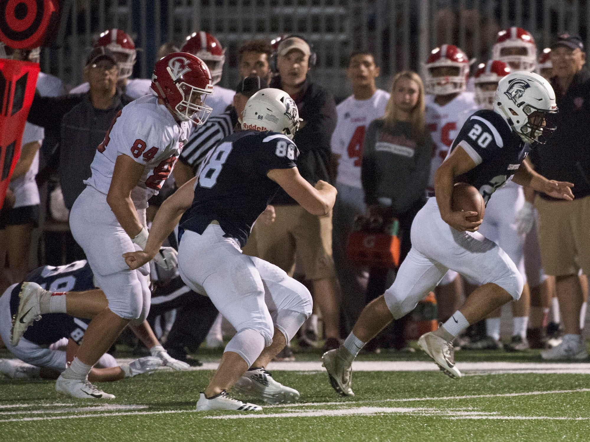 Chambersburg's Kyere Morton (20) returns a fumble to score. Chambersburg Trojans are 5-1 after a homecoming victory over Cumberland Valley 28-14 in PIAA football on Friday, Sept. 28, 2018.