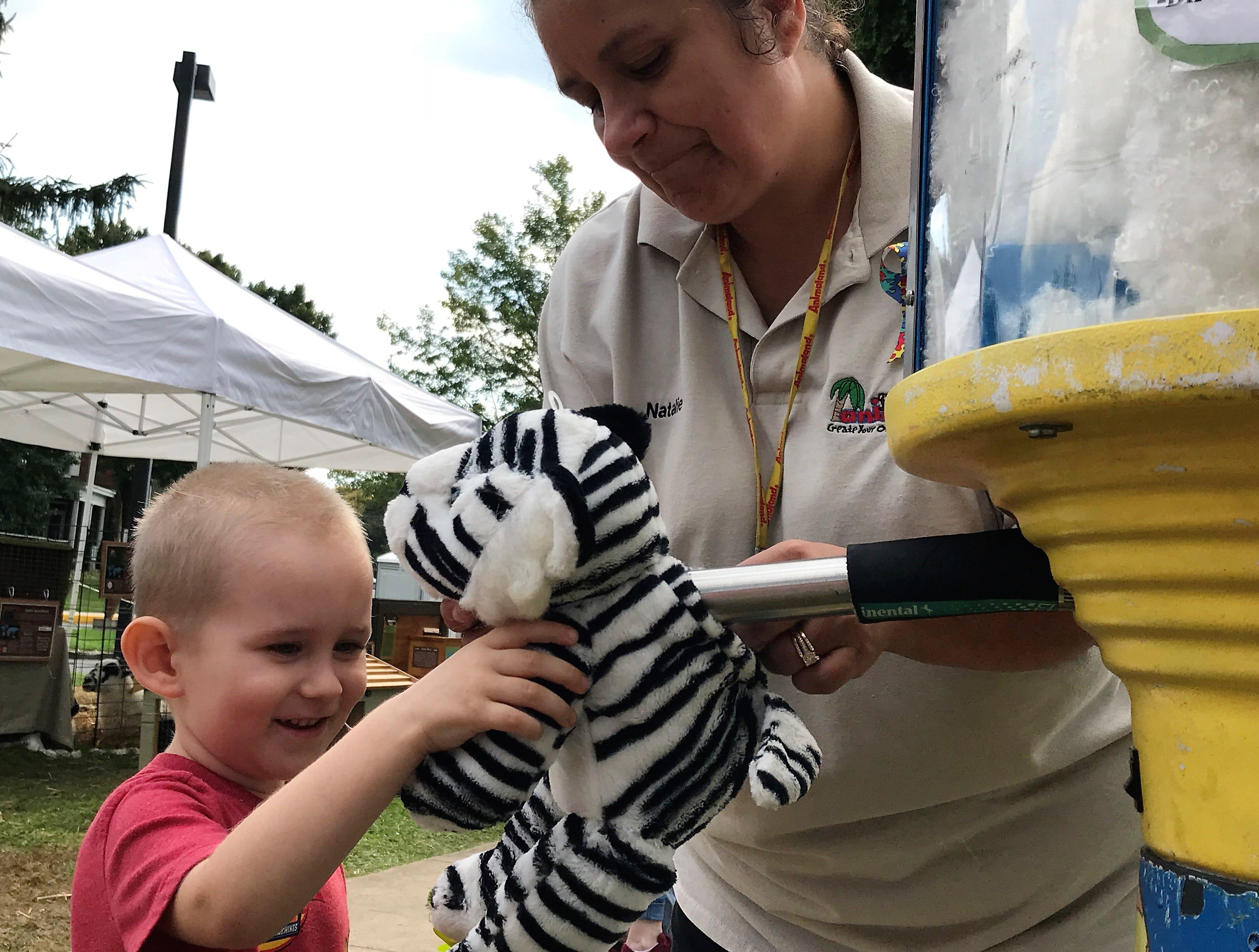 Quinntin Oberholzer, 4, Mercersburg, makes a stuffed animal on Saturday, Sept. 29, 2018, at Mercersburg Townfest.