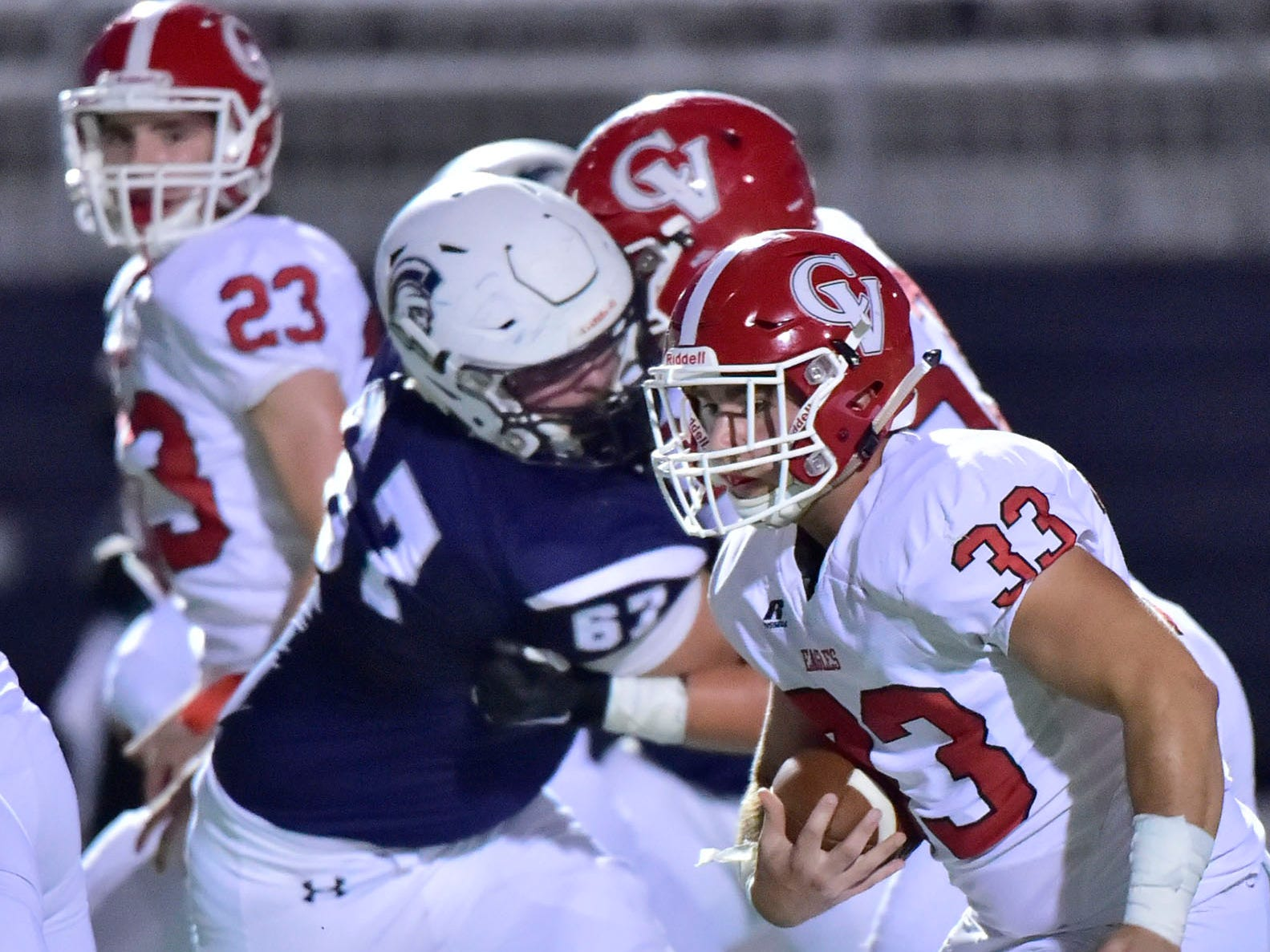 Chambersburg's Brock Harmon (67) moves in to tackle Conner Madison of Cumberland Valley (33). Chambersburg Trojans are 5-1 after a homecoming victory over Cumberland Valley 28-14 in PIAA football on Friday, Sept. 28, 2018.