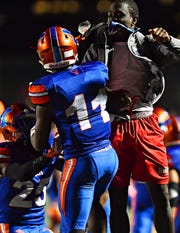 York High's Anthony Jamison, left, celebrates his one-handed touchdown catch. Dawn J. Sagert photo