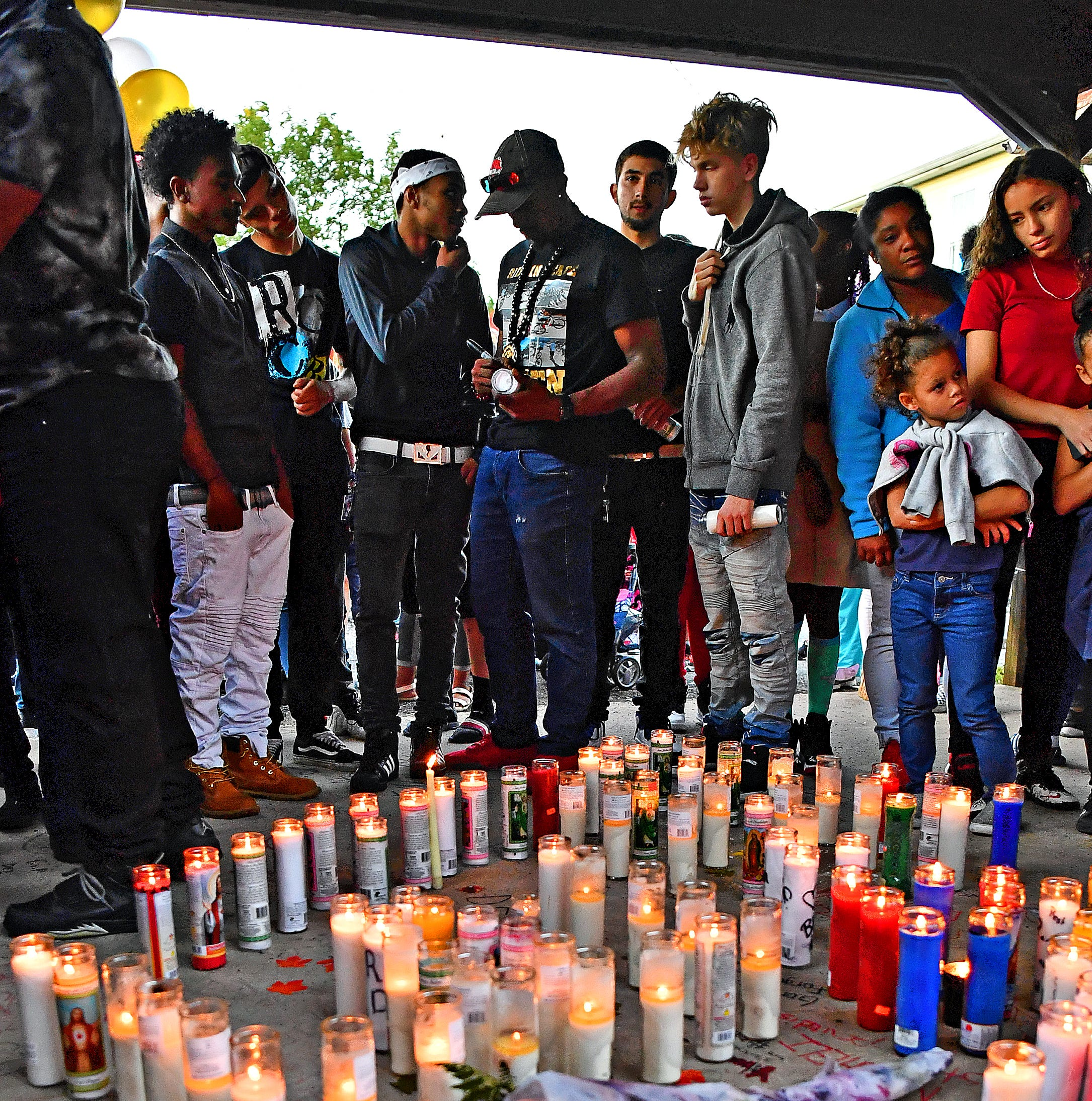 Dozens of family members and friends gather to remember shooting victim Dezmen Jones, 15, during a candlelight vigil behind a home at 613 West Princess Street in York City, Friday, Sept. 28, 2018. Jones was shot at the location on Wednesday, Sept. 26, and later died at York Hospital from his injuries. Dawn J. Sagert photo