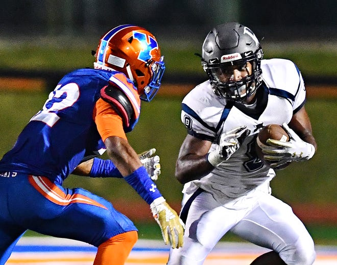Dallastown's Nyzair Smith tries to evade York High's Rob Rideout in the Wildcats' 68-35 loss last week. Dallsatown hosts New Oxford this week, while York High travels to Red Lion. Dawn J. Sagert photo