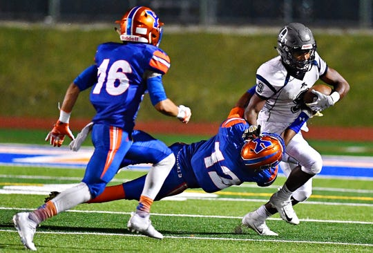 York High's Diontae Wilson, left, looks on as teammate Rob Rideout pulls down Dallastown's Nyzair Smith during football action at Small Athletic Field in York City, Friday, Sept. 28, 2018. York High's defense will face Cocalico and its veer offense on Friday night in a District 3 Class 5-A semifinal. Dawn J. Sagert photo