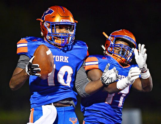 York High's Tyrell Whitt, left, and Anthony Jamison celebrate a touchdown made by Whitt during football action against Dallastown at Smalls Athletic Field in York City, Friday, Sept. 28, 2018. York High would win the game 68-35. Dawn J. Sagert photo