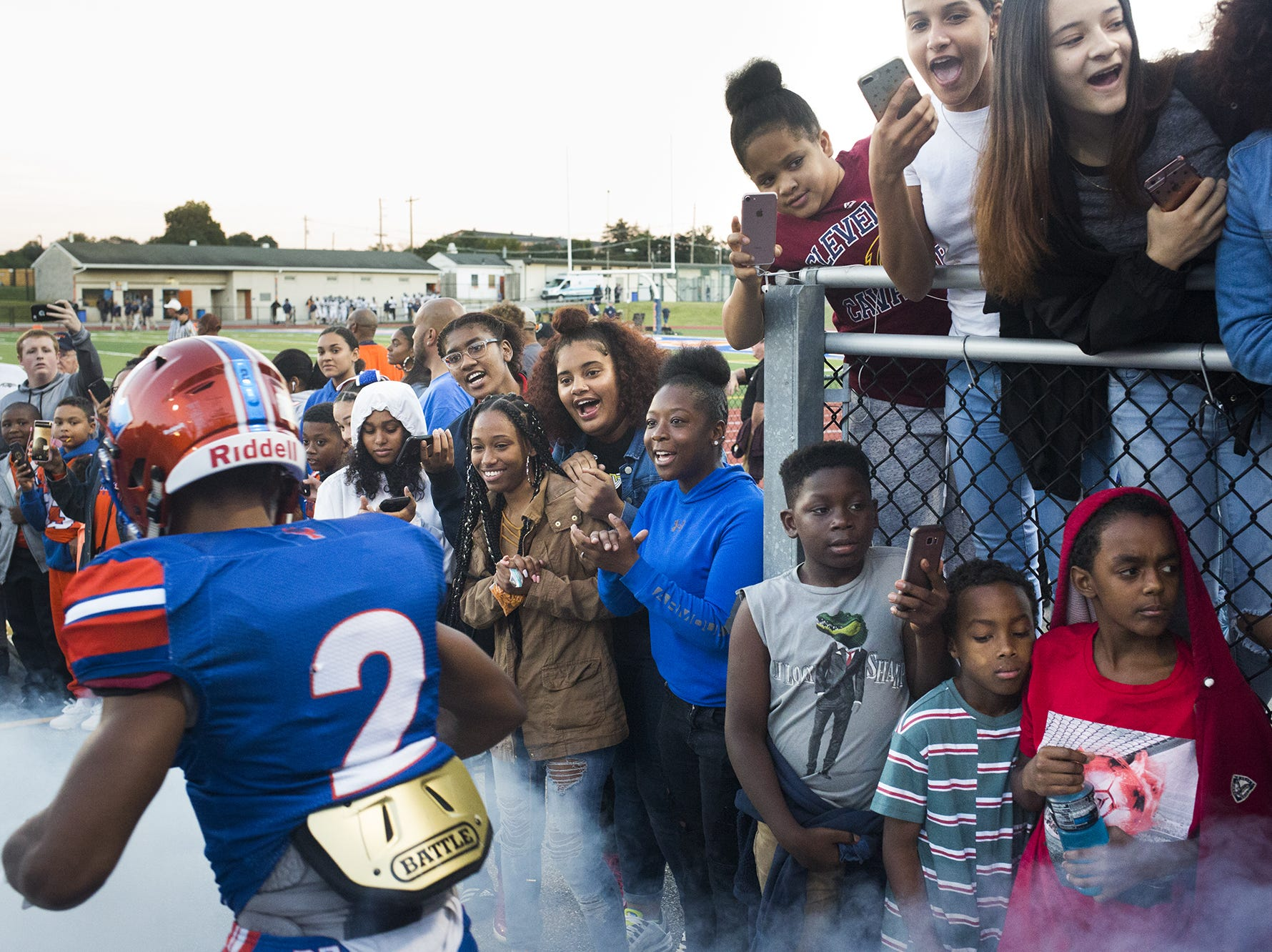 York High fans cheer as the team take s the field prior to the game. York High hosted Dallastown in football at Small Athletic Field in York, Friday, September 28, 2018.