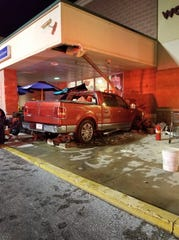A red pickup truck crashed into a Giant Food Store in West Manchester Township on Friday, September 28, 2018.