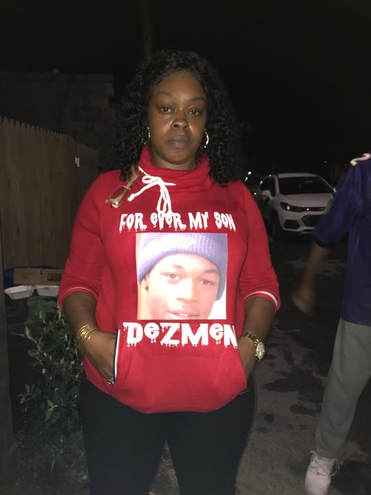 Kecia Hill, mother of Dezmen Jones, said her son would give a helping hand and took pride in everything he did. She hugged mourners at a vigil on Friday night.