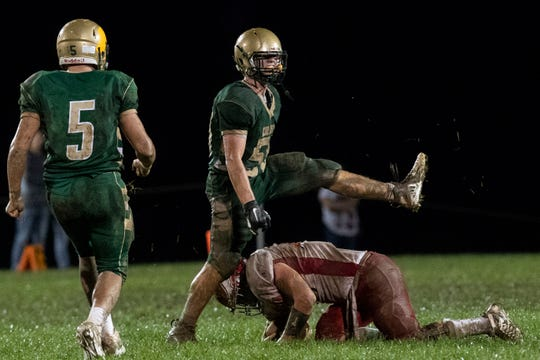 York Catholic's Harris Kohl (59) celebrates a big sack during a Division III football game on September 28, 2018. York Catholic (6-0) beat the Bermudian Springs Eagles (4-2) 10-7, during the Fighting Irish's homecoming.