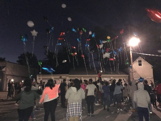 Mourners released balloons in memory of Dezmen Jones, who died Wednesday night after being shot in York.