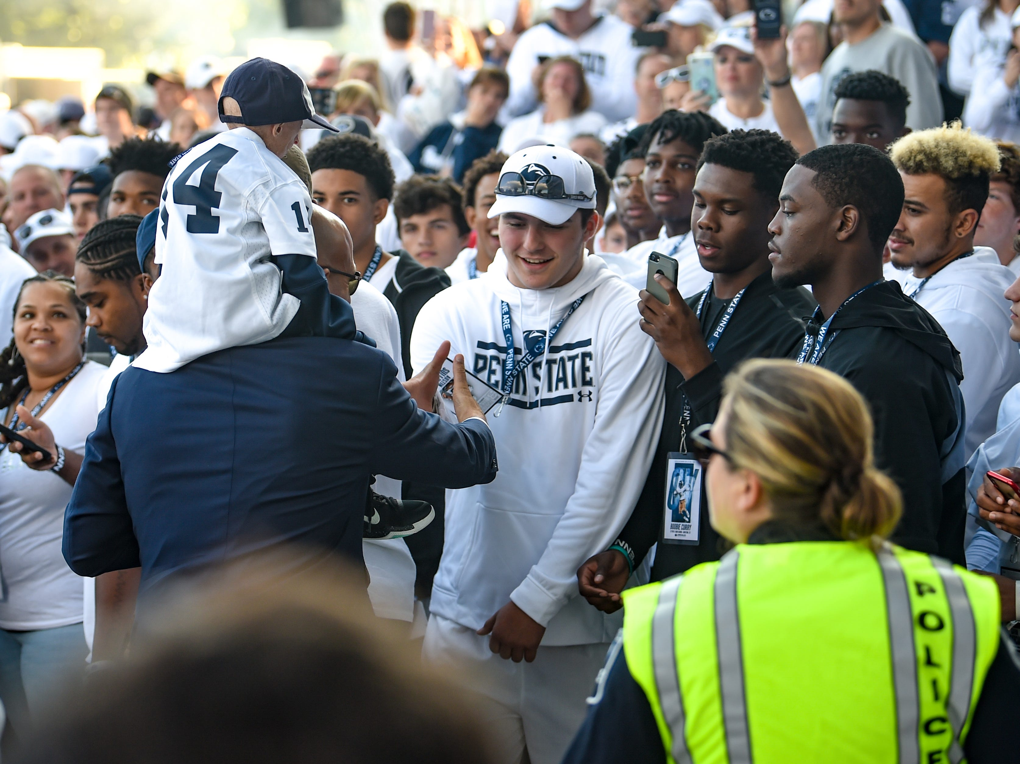 The recruits eagerly shake Penn State coach James Franklin's hand as he passes by, Saturday, September 29, 2018.