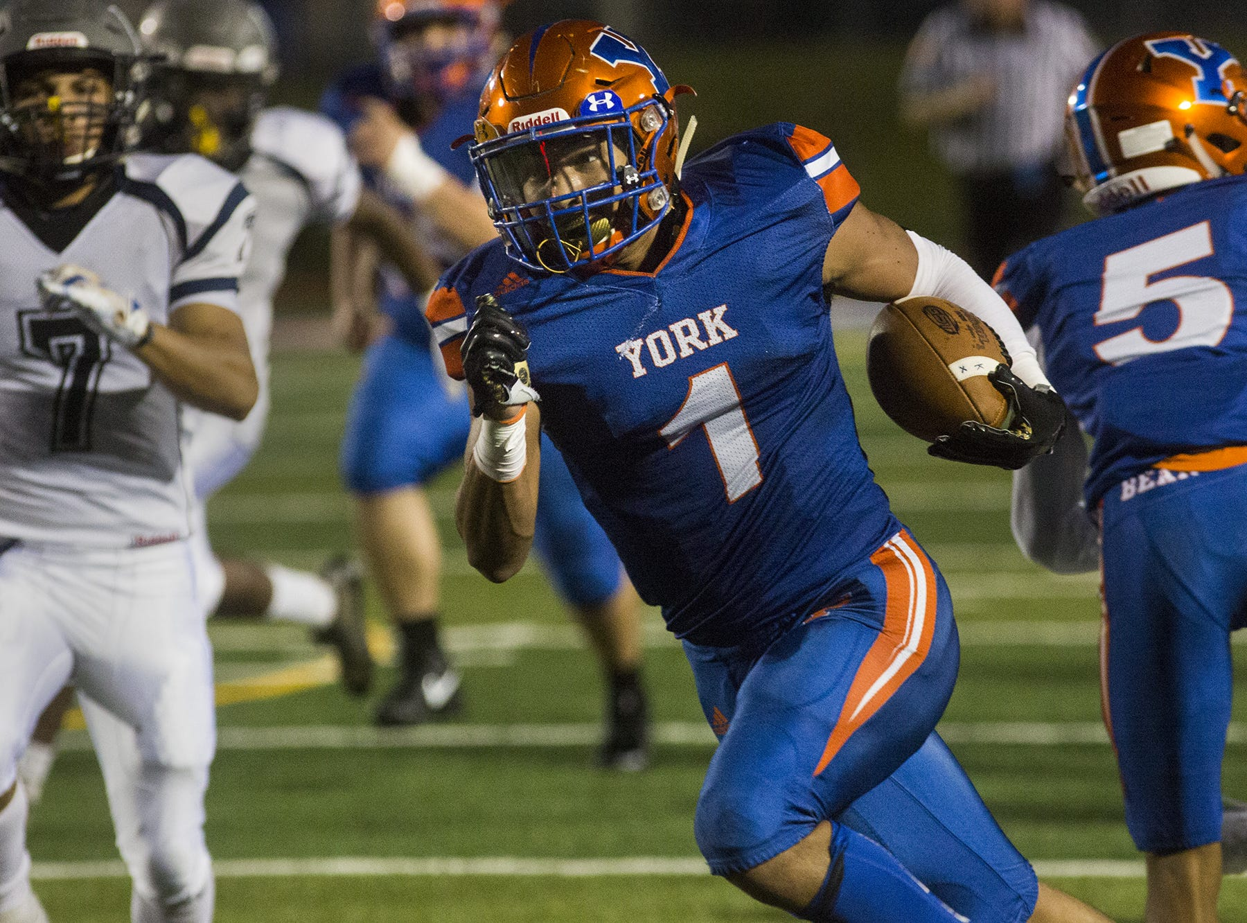York High's Dayjure Stewart, center, runs for the Bearcats' third touchdown of the game. York High defeated Dallastown 68-35 in football at Small Athletic Field in York, Friday, September 28, 2018.