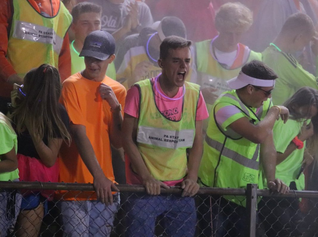 Students pull out the neon for Palmyra's homecoming game against Steel-High on Friday night.