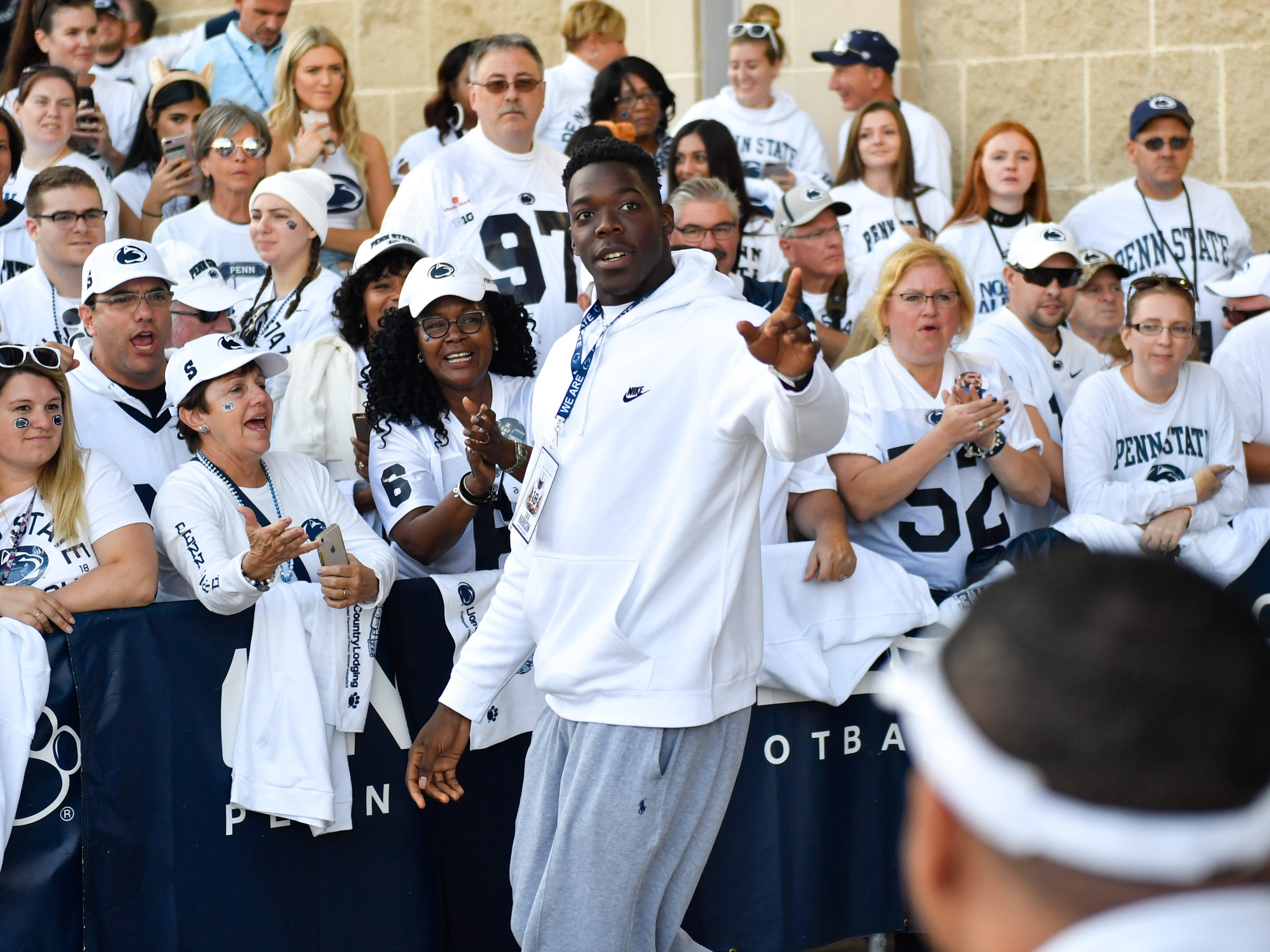 Penn State recruit Zach Harrison waves to the crowd before the team arrives for their game against the Ohio State University, Saturday, September 29, 2018.