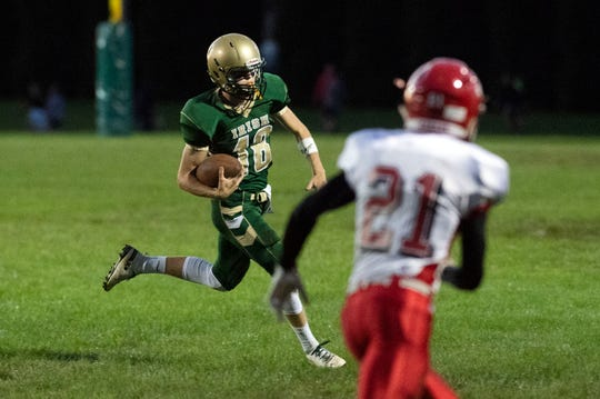 York Catholic's Wesley Burns (18) runs the ball up the field during a Division III football game on September 28, 2018. York Catholic (6-0) beat the Bermudian Springs Eagles (4-2) 10-7, during the Fighting Irish's homecoming.