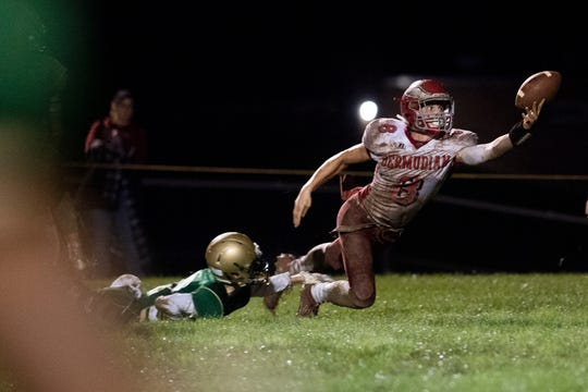 Bermudian Springs Chase McMillan (8) reaches out for a catch during a Division III football game on September 28, 2018. York Catholic (6-0) beat the Bermudian Springs Eagles (4-2) 10-7, during the Fighting Irish's homecoming.