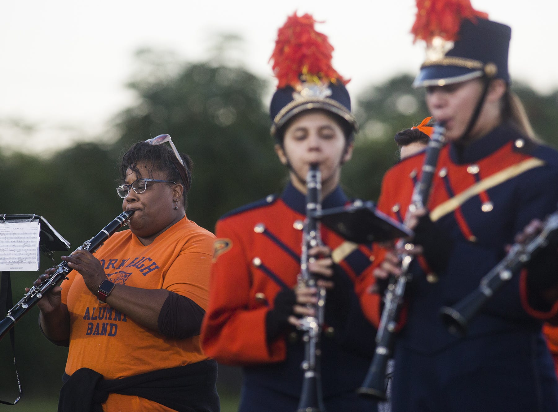 York High band alumni play with the York High School marching band prior to the game. York High hosted Dallastown in football at Small Athletic Field in York, Friday, September 28, 2018.