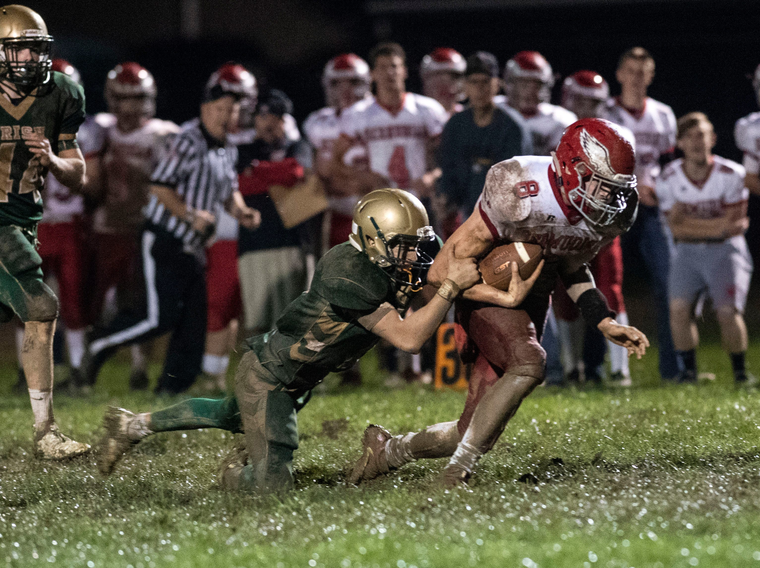 Bermudian Springs' Chase McMillan (8) gets taken down while fighting for yardage during a Division III football game on September 28, 2018. York Catholic (6-0) beat the Bermudian Springs Eagles (4-2) 10-7, during the Fighting Irish's homecoming.