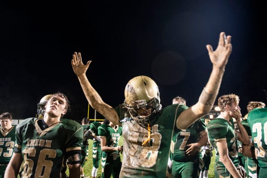 York Catholic quarterback Wesley Burns (18) celebrates the win during a Division III football game on September 28, 2018. York Catholic (6-0) beat the Bermudian Springs Eagles (4-2) 10-7, during the Fighting Irish's homecoming.