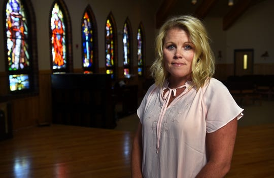 Brianne Thoreson, Principal of Bishop Manogue Catholic High School, poses for a portrait in her school's chapel in Reno on Sept. 27, 2018. Thoreson is a survivor of the mass shooting in Las Vegas.